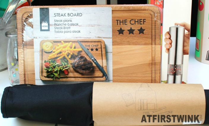 HEMA steak board and bbq set rolled in black apron, with kitchen tools