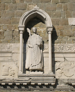 A 14th century statue of San Giusto di Trieste adorns the bell tower of the cathedral