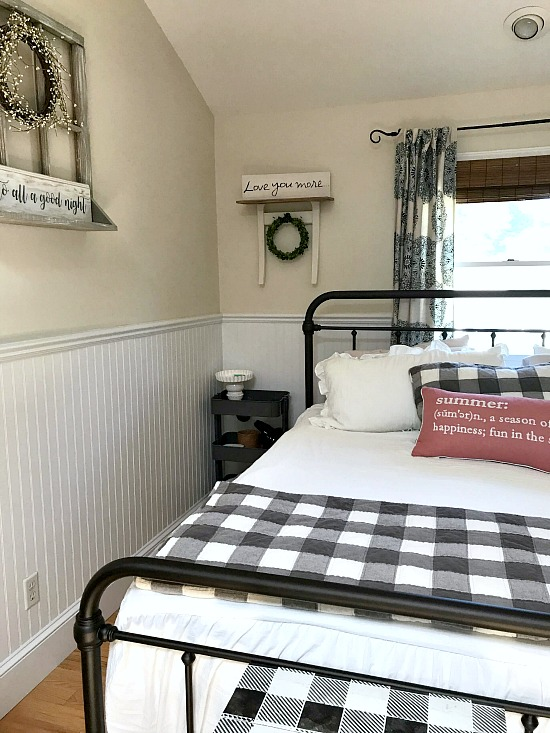 bedroom with iron bed and repurposed chair shelf