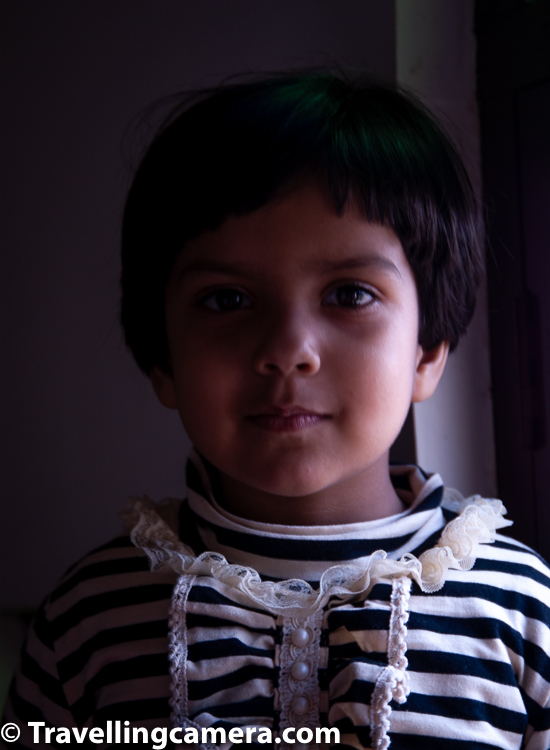 This photograph may look similar to above but there are shot in different lighting. Basic difference is that this photograph is clicked in softer light as shows on the face of this kid is transitioning smoothly while the photograph above has some harsh shadows on other side of nose. Take a pause and notice that and appreciate the different between lighting in both photographs and also the background in second one is not as dark I could have in first one. Similarity is that in both photographs, subject is lit with side light.     Related Blogpost - Tips to click Great People Portraits with your Phone Camera