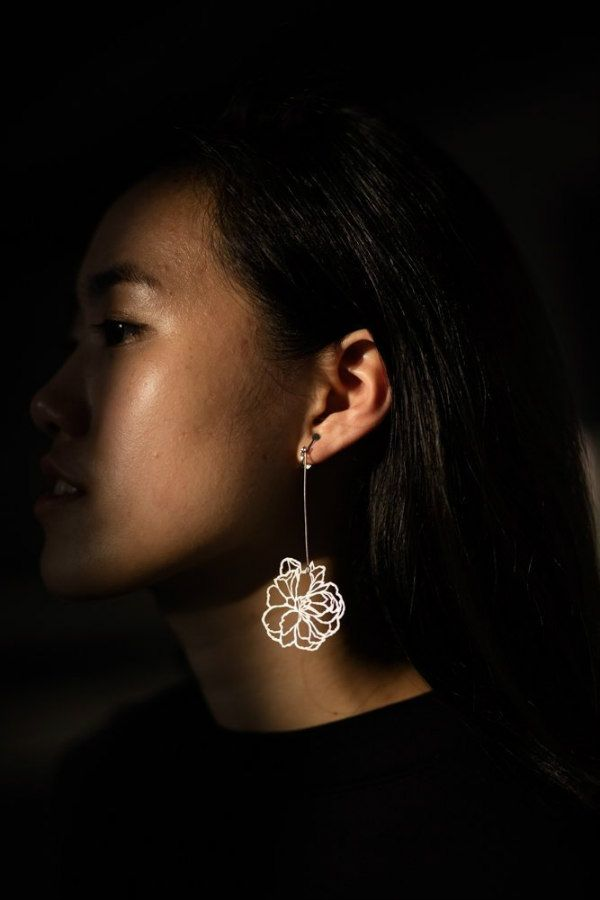 floral paper cut drop earring on model