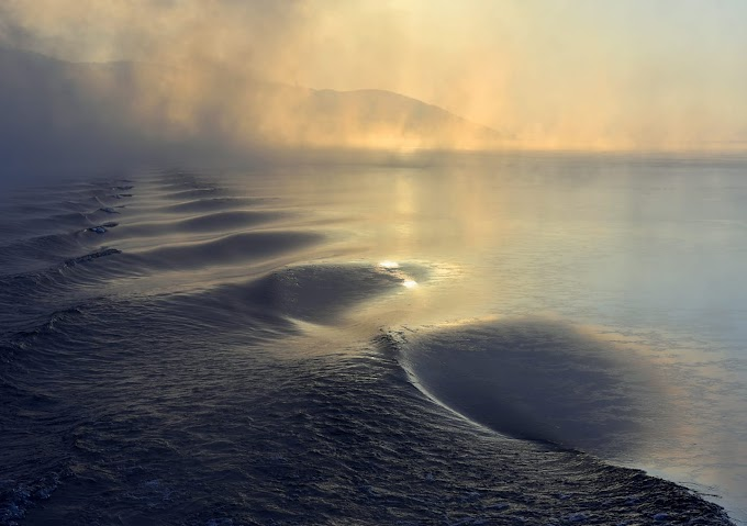 Water, ice and fire at Lake Baikal Siberia Russia