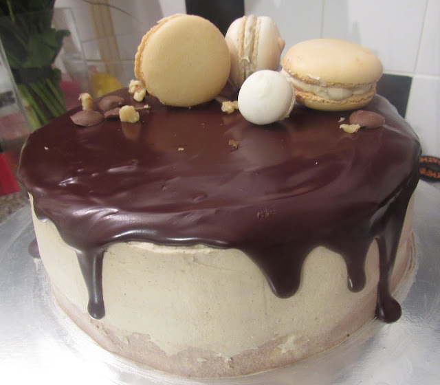 Chocolate Brownie Cake with Cinnamon brown sugar swiss meringue buttercream, chocolate drip and Italian macarons