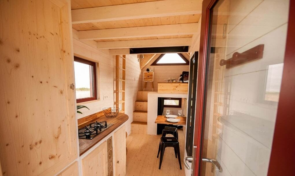 06-Kitchen-and-Dining-Area-Baluchon-Multi-Level-Prefabricated-Tiny-House-on-Wheels-www-designstack-co