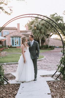 bride and groom at casa feliz arch