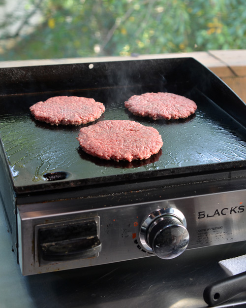 Cooking half-pound burgers on a Blackstone griddle