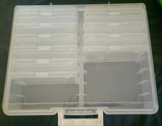 Top view of a plastic card container with labels on each card container.