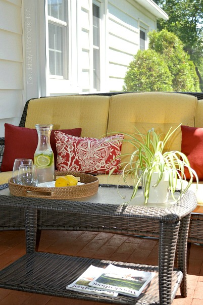 Wicker Outdoor Sofa Set in a screened in porch room