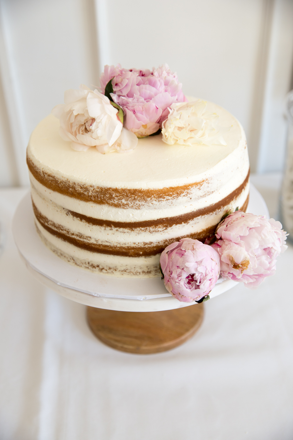 baby shower naked cake with peonies
