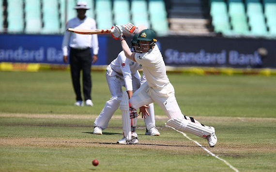 David Warner drives through the off side for Australia's Test Team against South Africa at Hollywodbets Kingsmead.