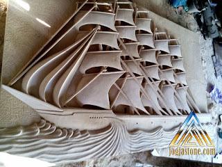 Relief kapal layar dibuat dari batu alam paras jogja/batu putih