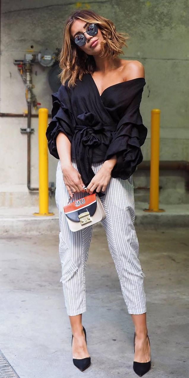 stylish look | black ruffle blouse + bag + heels + stripped pants