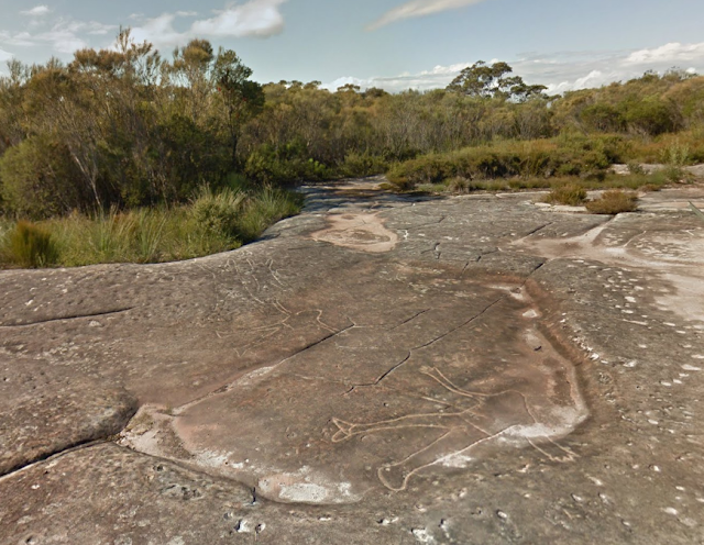 Basin site Aboriginal engravings in rock face