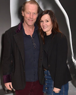Iain Glen with his wife Charlotte Emmerson