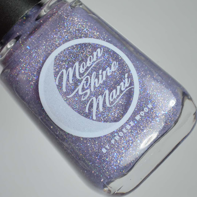 purple sparkle nail polish in a bottle