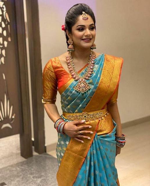 Bride in Mango Mala Jumbo Jhumkas