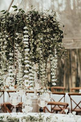 hanging flower chandelier under tent