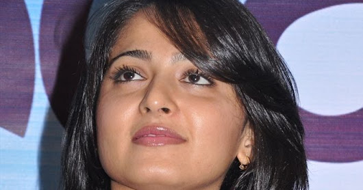 Anushka Shetty Long Hair Photos In Violet Dress