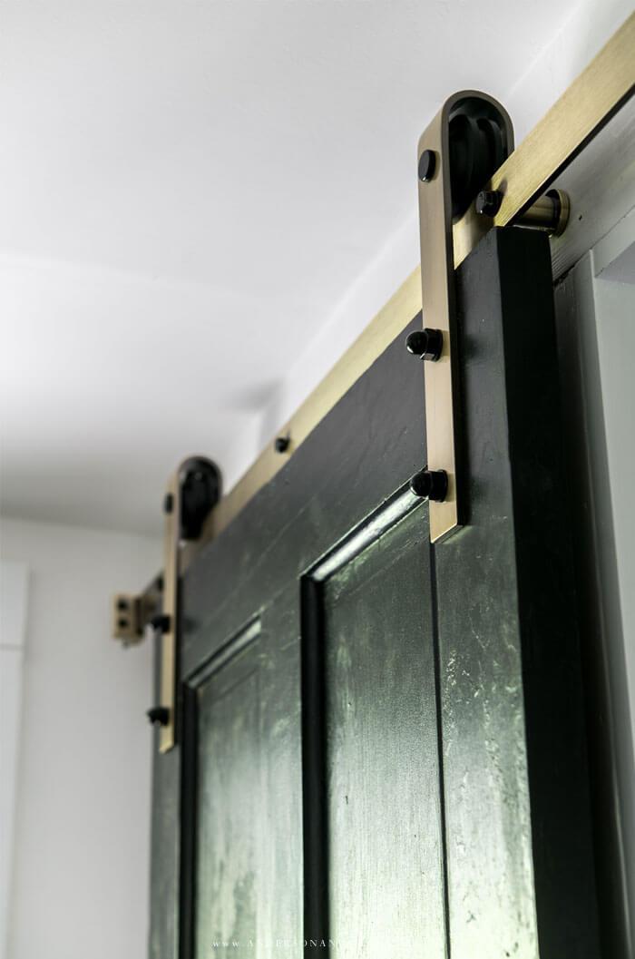 Brass barn door hardware
