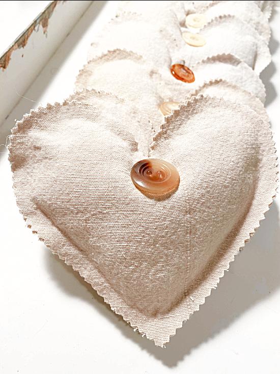 row of muslin hearts in a tray