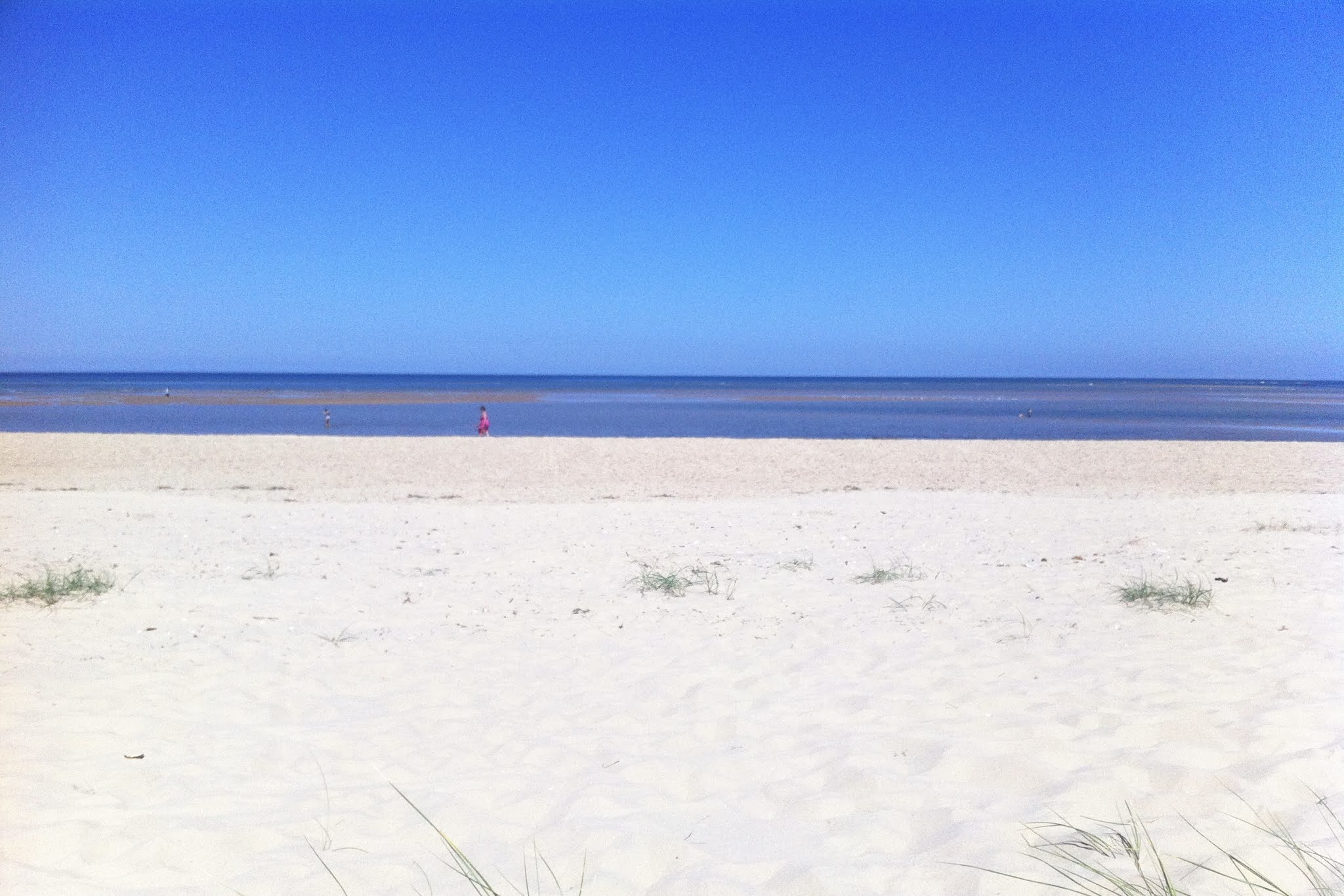 A sandy beach in North Norfolk and blue skies