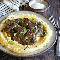 Chicken sausages served over creamy polenta with an onion pan gravy.