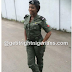 Pretty Policewoman Celebrates Birthday With  Cake Customized With Gun and Handcuffs