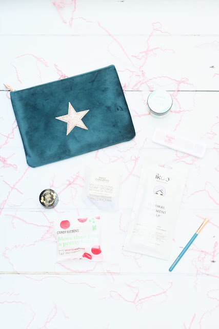 My December Birchbox featuring a variety of hair, skincare and makeup products
