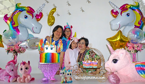 unicorn girl - unicorn onesies- unicorn cake - rainbow unicorn cake - unicorn cupcakes - 6th birthday pictorial - Bacolod Cupcake Cafe - unicorn foil balloons - Bacolod mommy blogger - birthday party - family portrait - rainbow unicorn cake - unicorn cupcakes - unicorn foil balloons