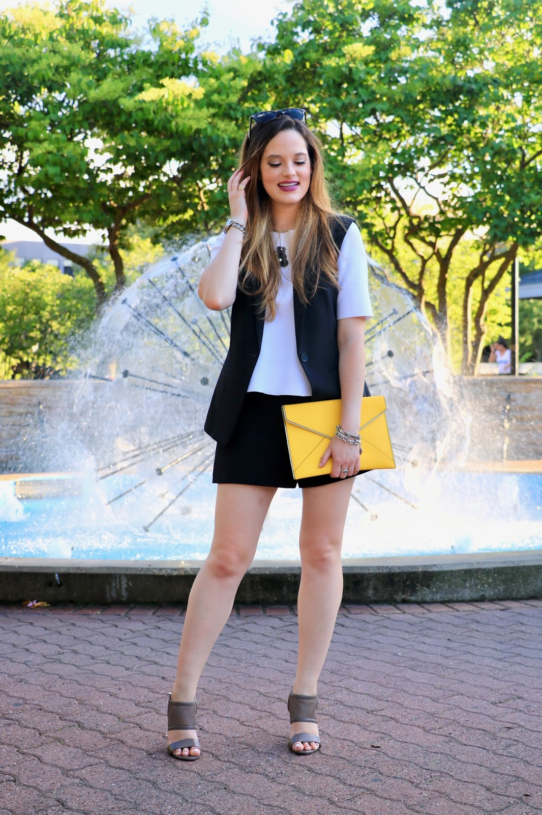NYC fashion blogger Kathleen Harper of Kat's Fashion Fix wearing shorts with a vest for office style