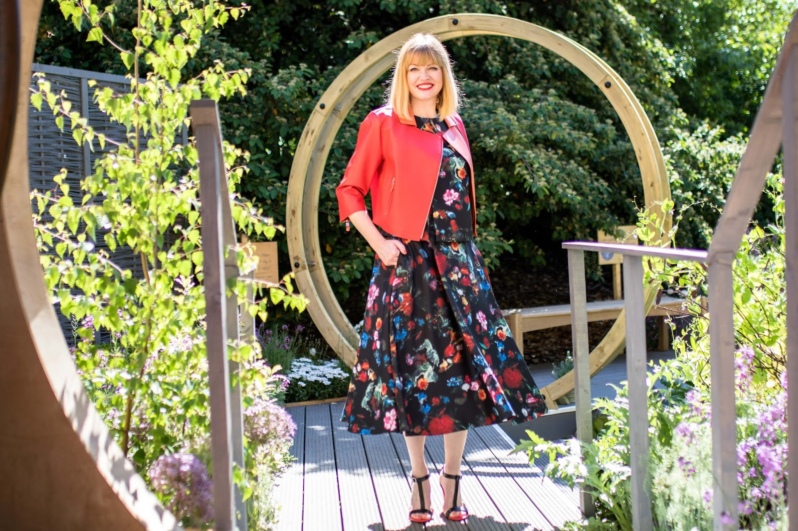 What-Lizzy-Loves-Madeleine-black-floral-peplum-top-matching-floral-midi-skirt-tomato-red-leather high-heeled-sandals-red-leather-biker-jacket-what-to-wear-Chelsea-Flower-Show