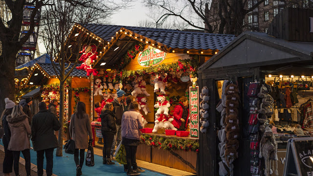 visitors looking into outdoor holiday pop-up shops