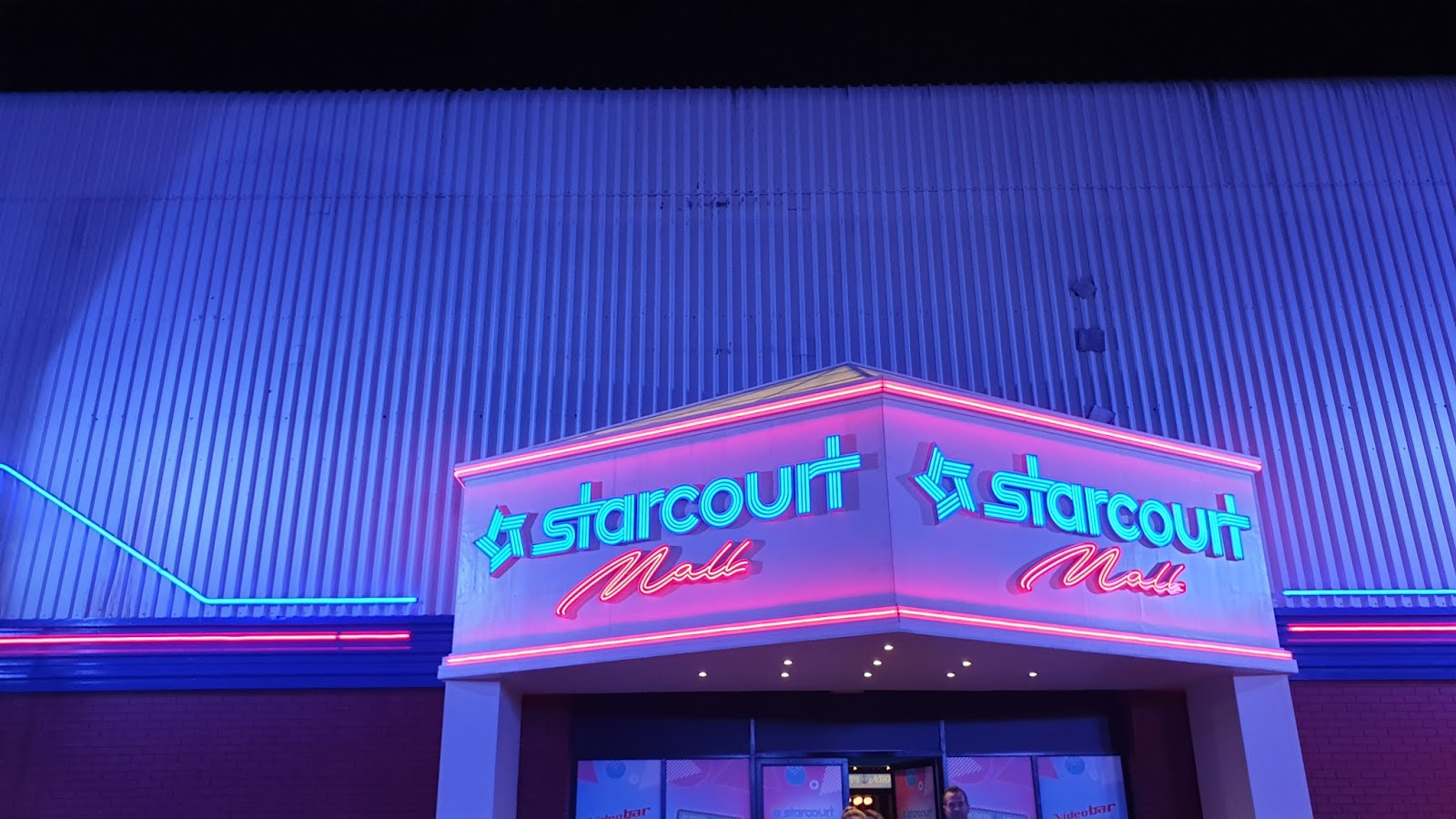 starcourt mall entrance neon lights