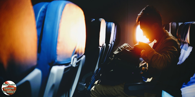 "Header image of the article: ""6 Tips To Get Over Flight Anxiety And Relax On A Plane"". Man plane worried, fear of flying, anxiety, how to get over and relax"