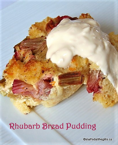 Rhubarb Bread Pudding served with a spoonful of pouring cream.