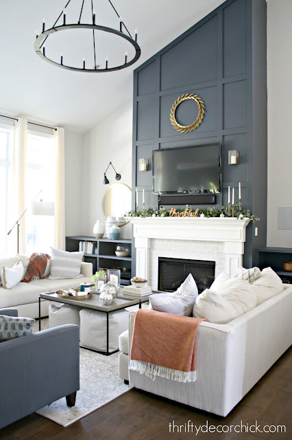 Dark blue tall fireplace wall with molding