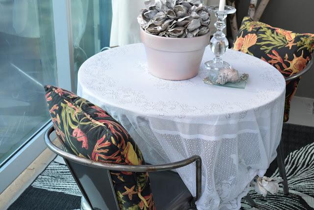 Small Balcony idea using,Shells; glass candle holder ; Patio, table cloth & linen