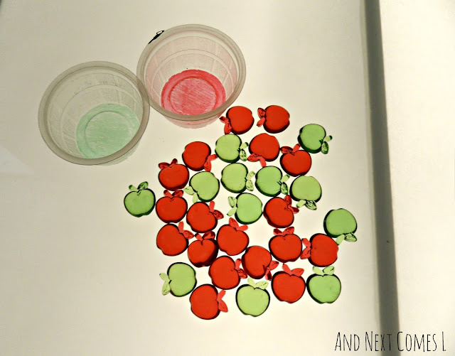 Apple theme activities for preschoolers on the light table