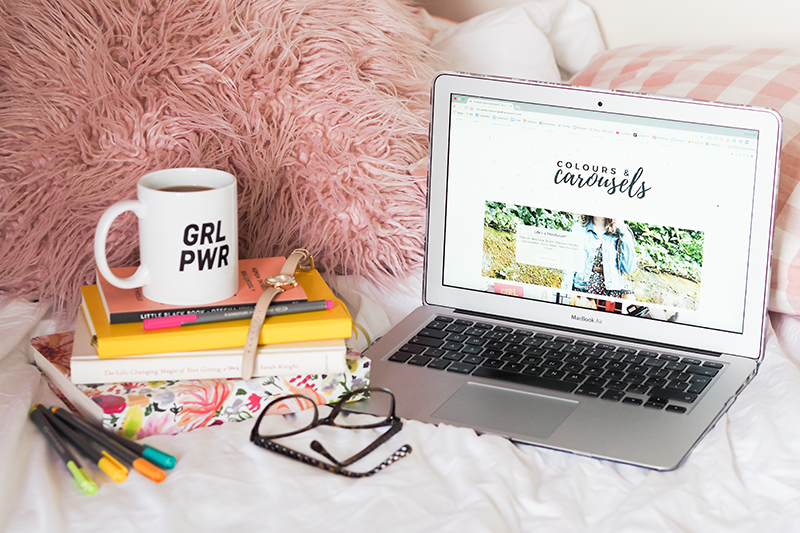 Open laptop and GRL PWR mug on pile of books with glasses | Colours and Carousels - Scottish Lifestyle, Beauty and Fashion blog