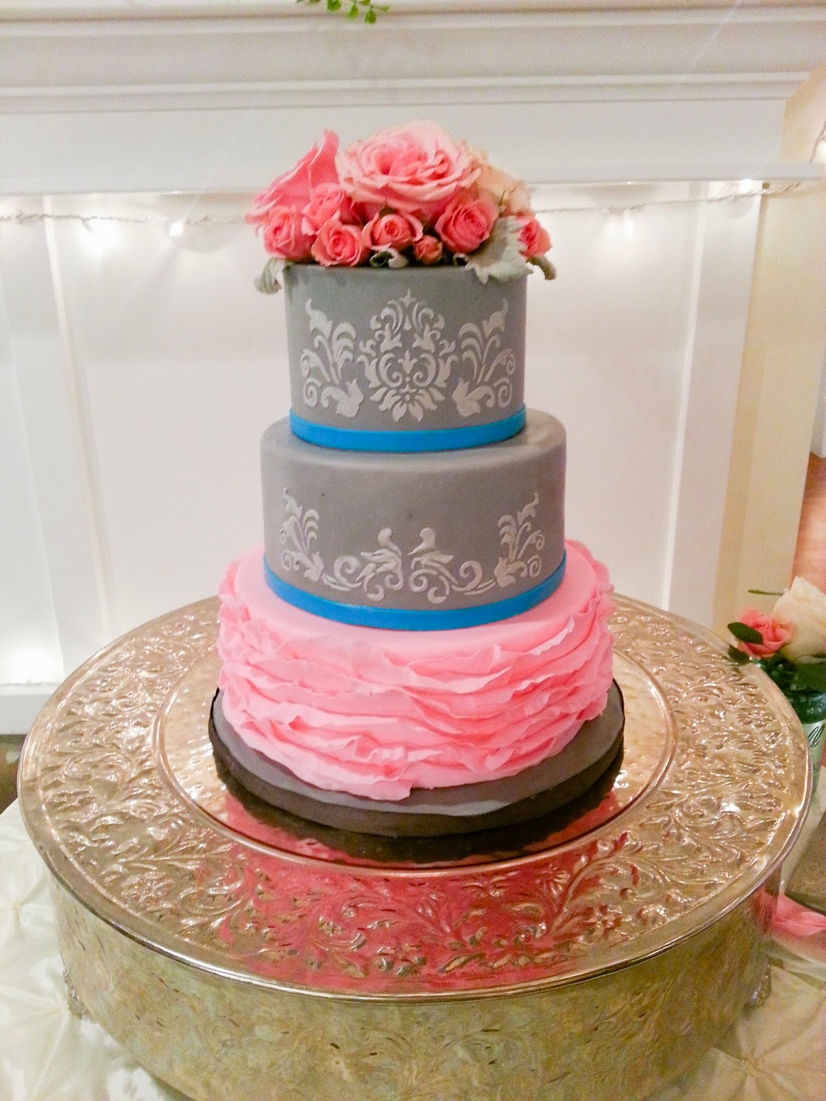 Pink roses, navy blue ribbon, 4 tiered Wedding cake at ... |Pink And Blue Wedding Cakes