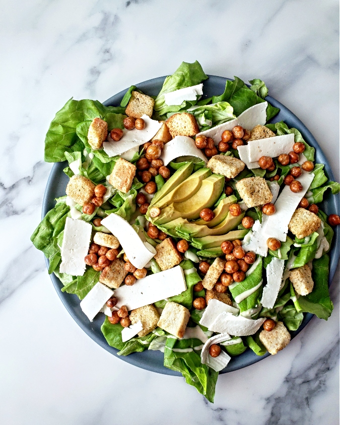 Salad with croutons, cheese, avocado, and crispy chickpeas