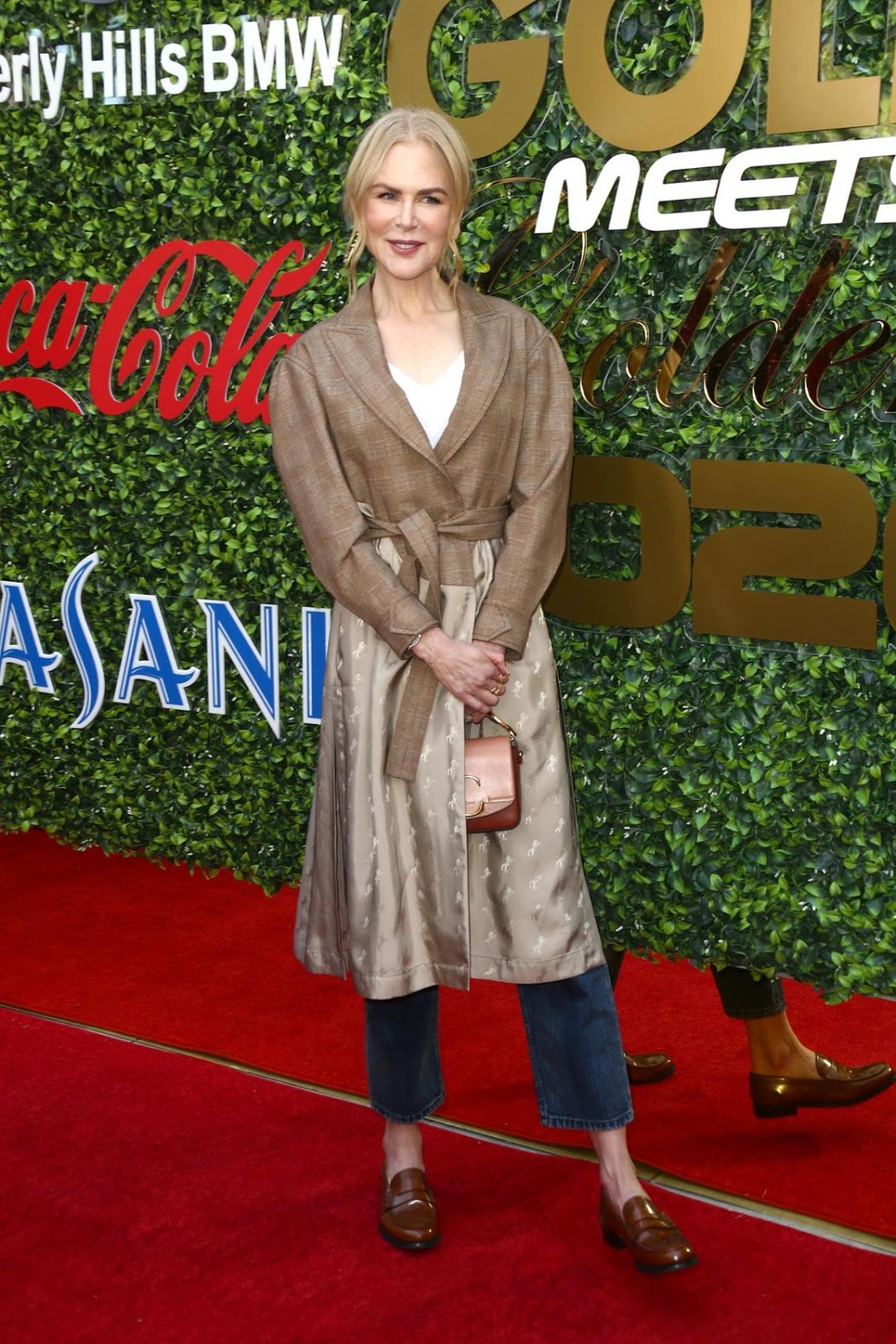 Nicole Kidman channels relaxed Hollywood glam in a tan-hued trench coat at the Gold Meets Golden brunch in Los Angeles