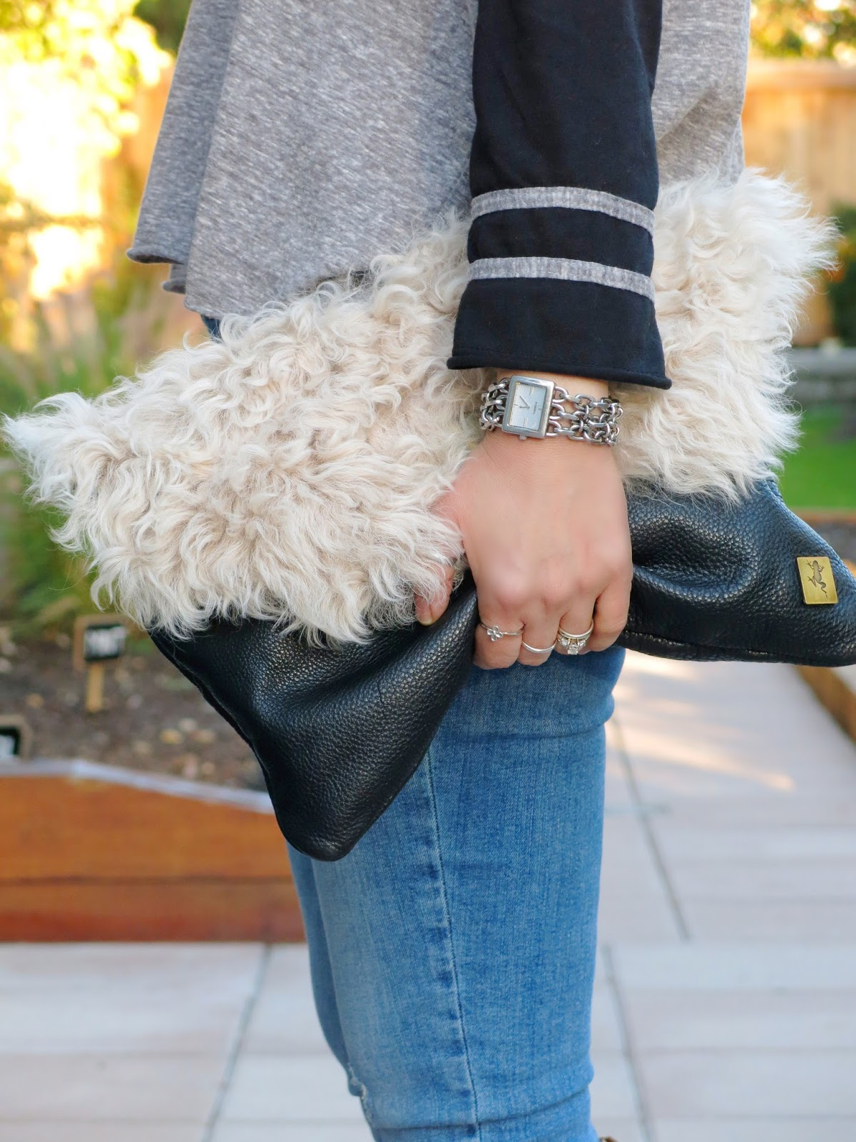 baseball-style tee and sherpa clutch