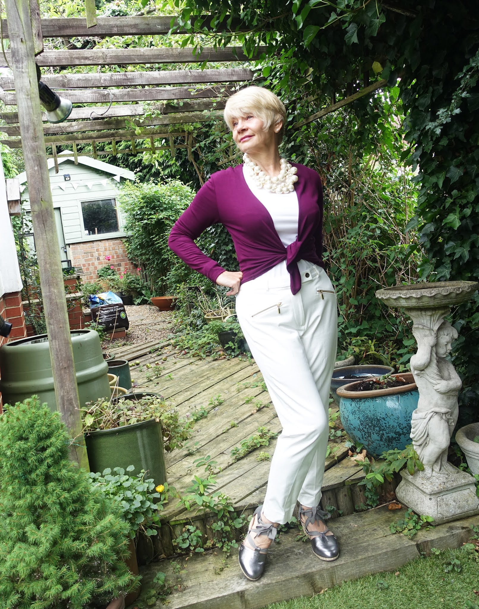 Is This Mutton reviews nearly two years of lockdowns, the good, the bad and the ugly. Gail Hanlon wearing all-white with a Kettlewell beetroot short tie wrap and Vionic wedge shoes,.
