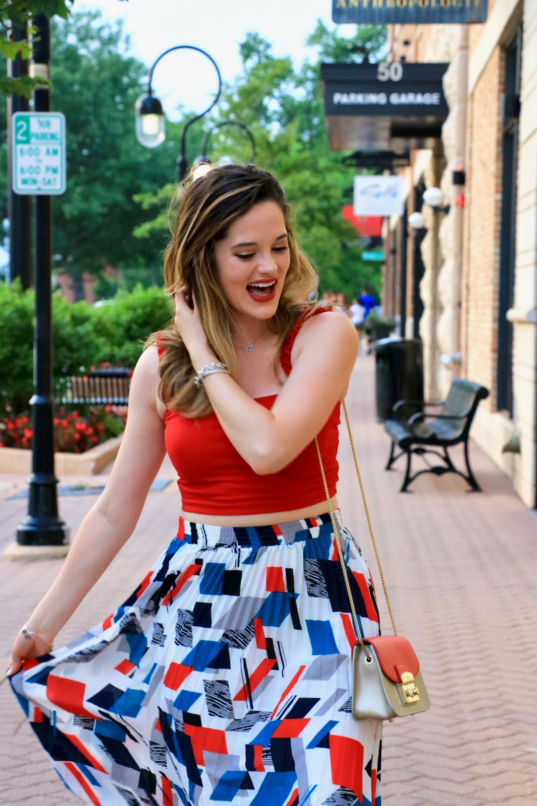 Nyc fashion blogger Kathleen Harper wearing a summer midi skirt outfit.