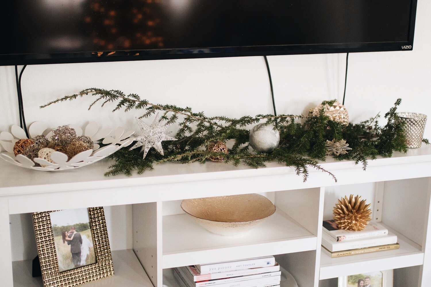 pretty christmas decor for a console table using fresh greenery clippings