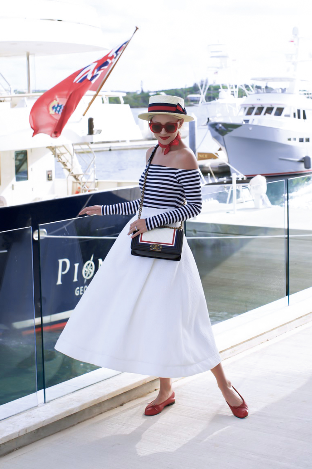 woman close to the boat wearing nautical outfit