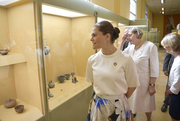 Crown Princess is wearing pleated printed silk midi skirt, and silk shirt half sleeve top at Ancient Agora Museum