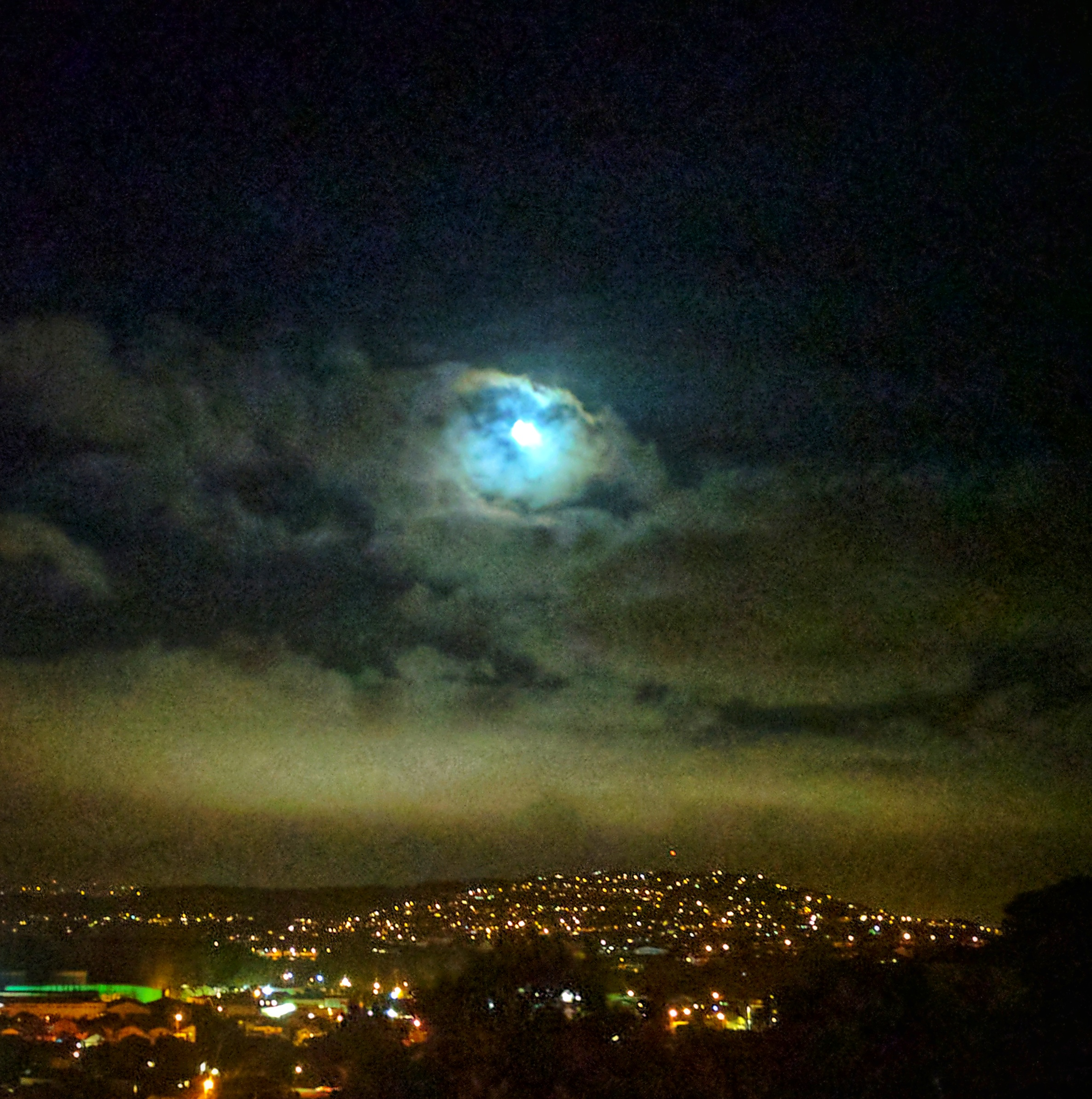 Moonlit clouds over Wellington street lights
