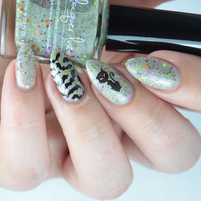 holographic nail polish with halloween stamping